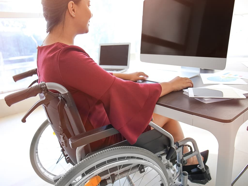 Lady in wheelchair at work